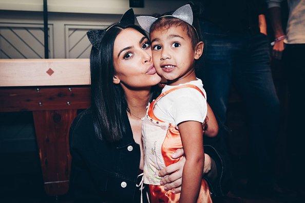 Kim Kardashian And North West Attend Ariana Grande