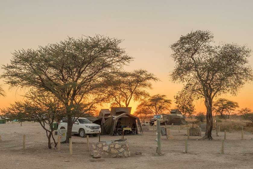 Sunrise at the camping sites in the Okaukeujo Rest Camp NAMIBIA