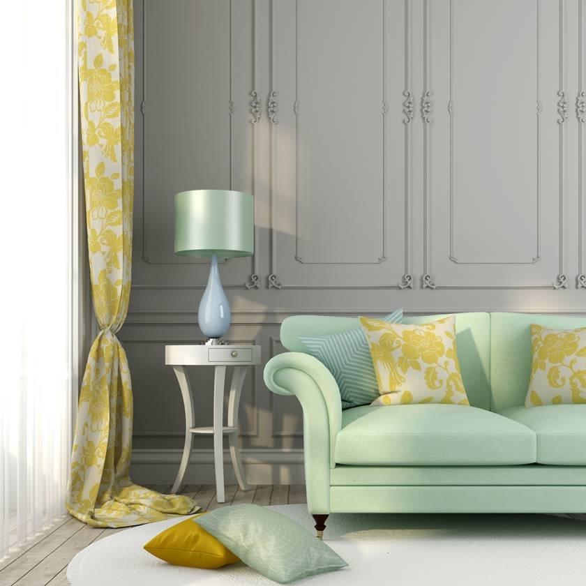 Green sofa yellow pillows
