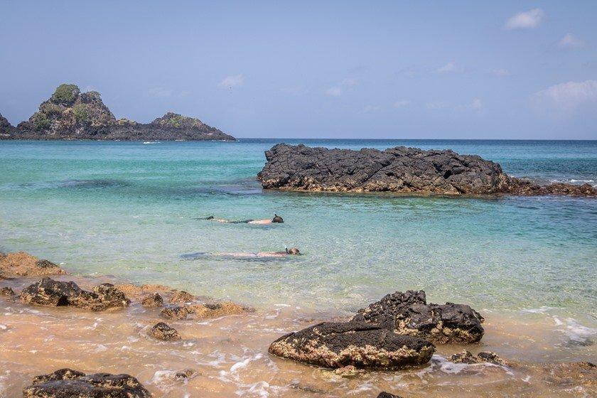 People Snorkeling at Praia do Sancho Beach - Fernando de Noronha, Pernambuco, Brazil