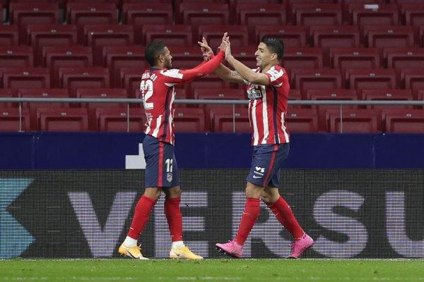 Renan Lodi e Luis Suárez