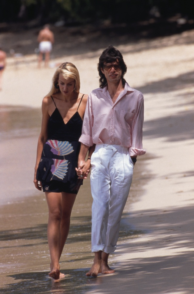 Mick Jagger and Jerry Hall on a beach in Mustique, 18th February 1987