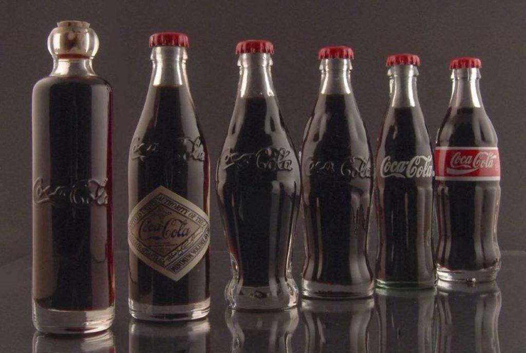 história das garrafas de Coca Cola