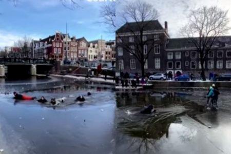 Pessoas afundam em canal congelado Amsterdã patinadores