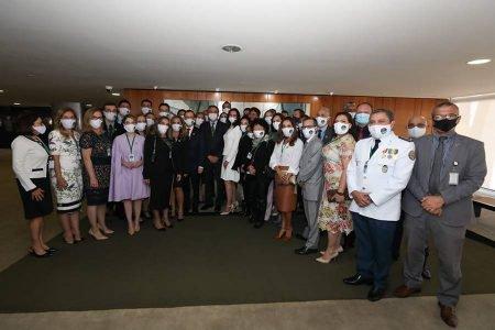 O presidente Jair Bolsonaro reunido com o suposto
