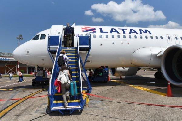 PUERTO MALDONADO, SPAIN - 2019/09/11: Passengers seen boarding a LATAM Airlines Airbus 320 at Puerto Maldonado airport also know as Padre Aldamiz International Airport. (Photo by John Milner/SOPA Images/LightRocket via Getty Images)