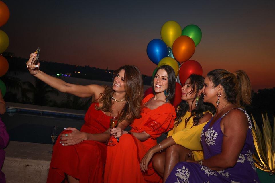 Claudia Salomão oferece happy hour em comemoração ao aniversário de Cleucy Oliveira