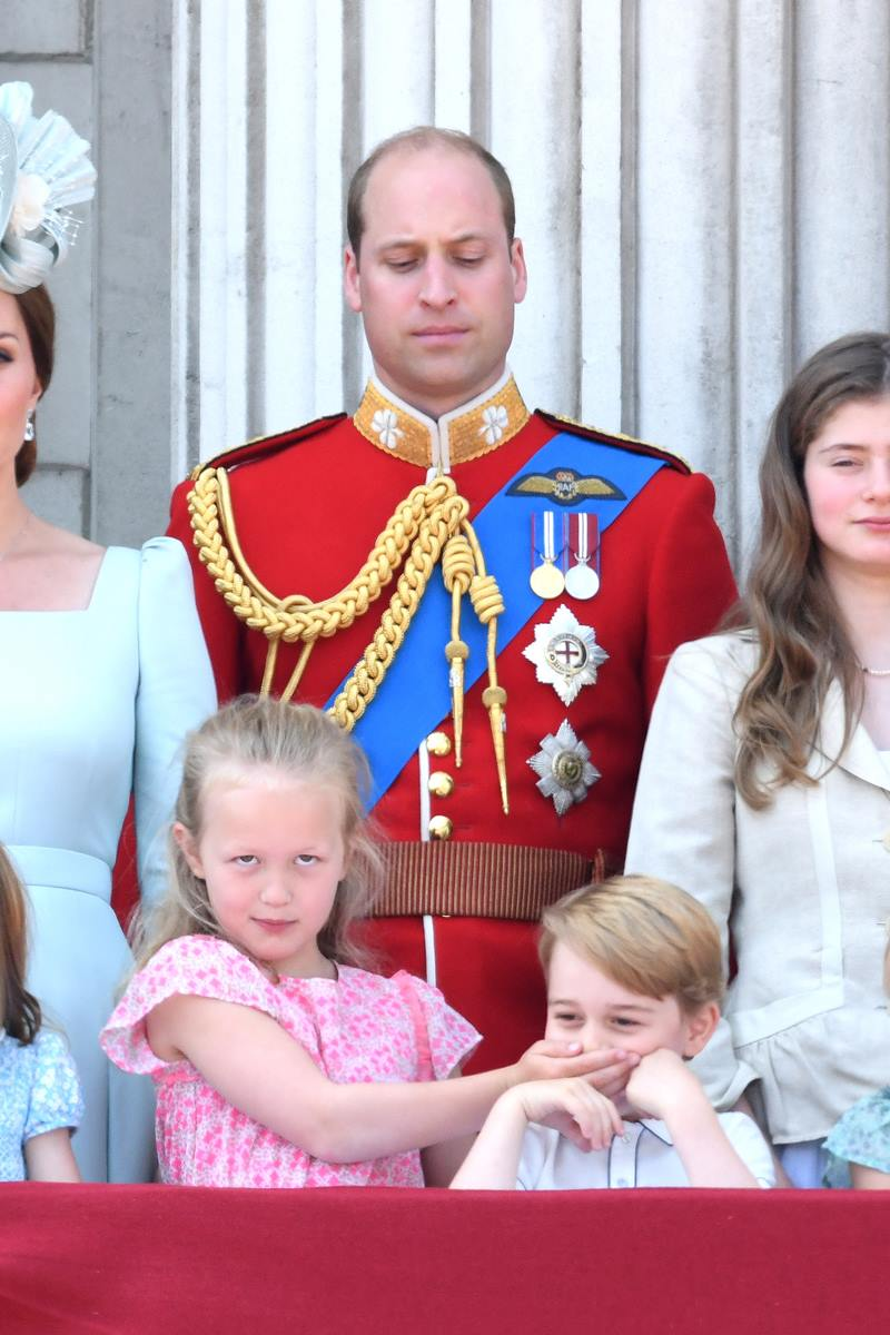 Prince William, Duke of Cambridge, Savannah Phillips and Prince George of Cambridge on the balcony of Buckingham Palace